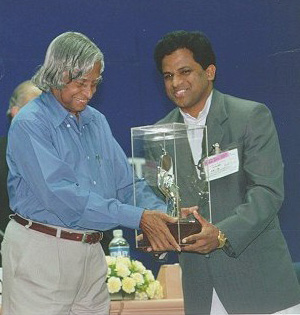 Receiving the 1st Computer Excellence Award for Schools from President APJ Abdul Kalam